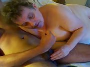 Mature nanny shows her black lover a good time while sucking him off
